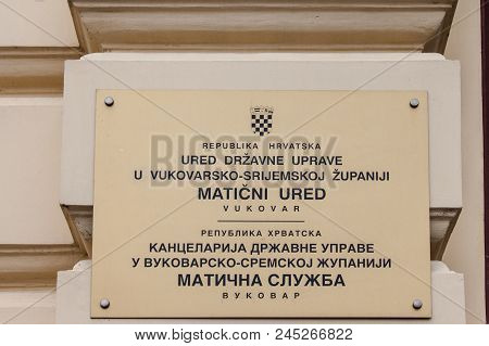Vukovar, Croatia - February 25, 2018: Bilingual Plaque On A Croatian Administration Both In Croatian