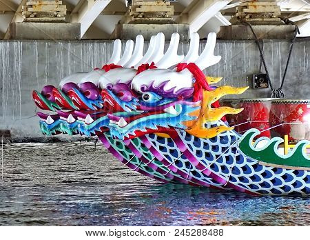 Kaohsiung, Taiwan -- June 10, 2018: A Row Of Dragon Boats With The Traditional Figureheads Is Being