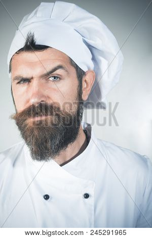 Cooking. Profession And People Concept. Portrait Of Bearded Chef. Confident Bearded Male Chef In Whi