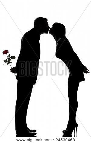 one caucasian couple man and woman kissing in studio silhouette isolated on white background