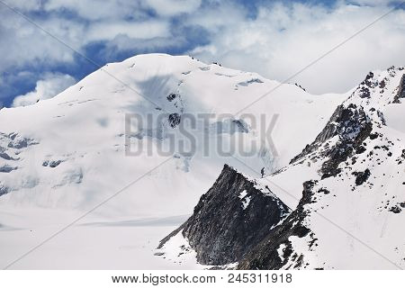 Snowy Peak In The Mountains