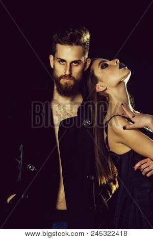 Fashionable Couple. Couple Of Bearded Man In Coat And Pretty Woman In Dress With Long Hair Has Fashi