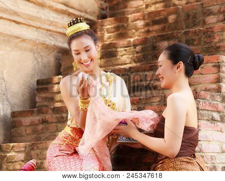 Asian Noble Beauty With Maid Dressed In Traditional Clothes Shopping In Old Retro Historical Period