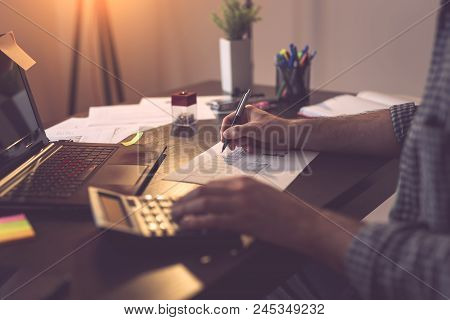 Male Accountant Working In A Home Office