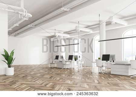 Modern Company Office Interior With White Computer Tables, Arched Windows And A Wooden Floor. Concep