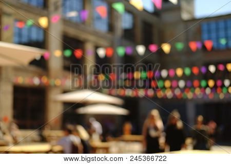 Summer Street Food Festival. Festive Urban Blurred Background With People.