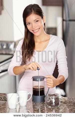 Woman Making Coffee In Kitchen