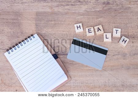 Stethoscope  And Book Note On Wood