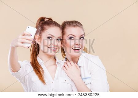 Fun Bonding Selfie Concept. Sisters Or Best Friends, Two Student Blonde Girls Taking Self Photo With