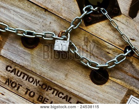 Silver Key Chain Lock On The Wood