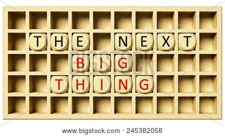 3d illustration of a wooden grid with cubes and the message the next big thing