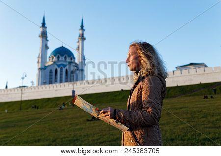 Woman Tourist Holding A Tourist Map