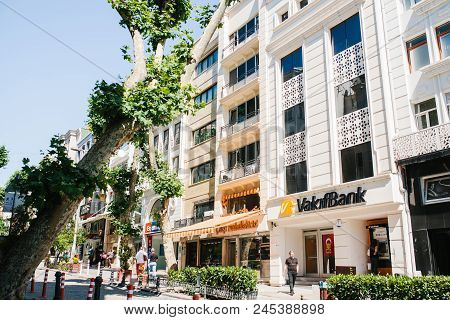 Istanbul, June 17, 2017: City Street With A Bank Building And Shops. People Walk Down The Street. Or