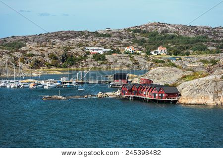 Sea Landscape Of A Rocky Coastline And Small Village On The South Of Sweden. Southern Coastline Of S