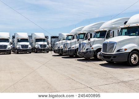 Indianapolis - Circa June 2018: International Semi Tractor Trailer Trucks Lined Up For Sale. Interna