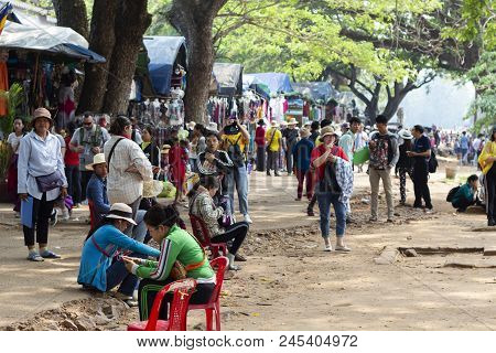 Siem Reap, Cambodia - 25 March 2018: Public Market And Tourists Near Angkor Wat Temple. Tourist Indu