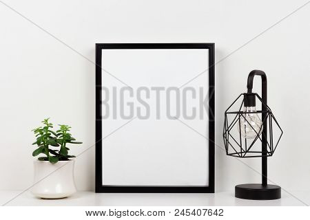 Mock Up Black Frame, Succulent Plant And Industrial Style Lamp On A Shelf Or Desk. White Shelf And W