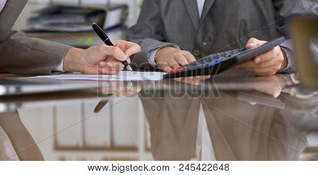 Two Female Accountants Checking Financial Statement Or Counting By Calculator Income For Tax Form, H