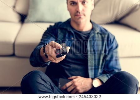 Caucasian man using remote tv controller