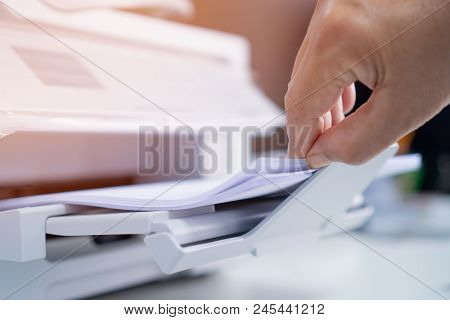 Business Office Concept : Hand Businessman Is Process Of Press Paper On Laser Print Cartridge, Lay D