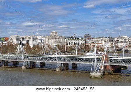 Aerial View Of Hungerford Bridge, A Steel Truss Railway Bridge, Flanked By The Golden Jubilee Bridge
