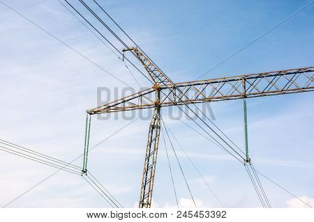 Power Lines Tower Against The Blue Sky. Lovely Energy Industry Background. Efficient Electricity Del