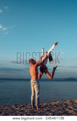 Couple In Love Dancing, Having Fun, Sea And Skyline Background. Couple In Love Stand On Beach, Seash