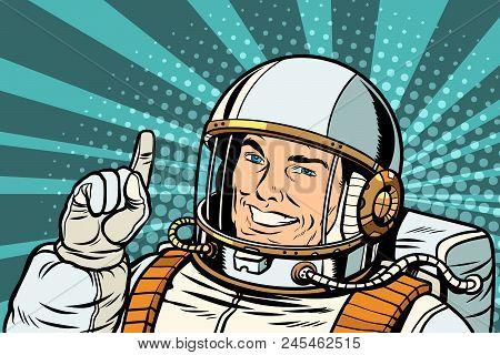 Pop Art Astronaut Points Up. Retro Vector Illustration Kitsch Vintage Drawing