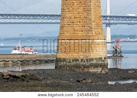 Forth Bridge Scotland And Landing-stage For Launches. In The Background The Forth Road Bridge And Qu