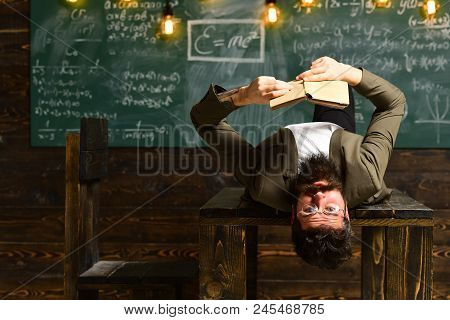 Businessman In Suit Read On School Desk. Bearded Man Read Book In Classroom. Scientist Hipster With