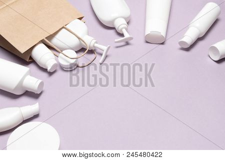 Various Cosmetic Products With Paper Packaging Bag. Women Skin Care Checklist. Beauty Shopping Conce