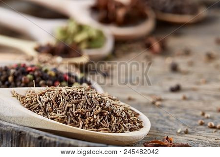 Colourful Aromatic Various Spices For Cooking On An Old Wooden Barrel, Close-up, Flat Lay, Selective