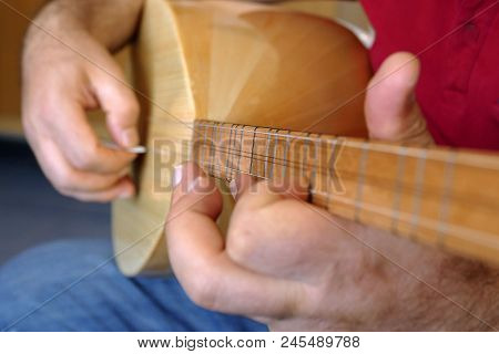 Man Playing Turkish Saz, Man Playing Turkish Saz.(bağlama)