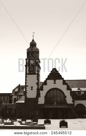 The Historic Building Of The Main Station In Bad Homburg In The Backlight.