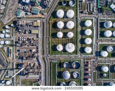 Industrial View At Oil Refinery Plant Form Industry Zone With Sunrise And Cloudy Sky.oil Refinery An