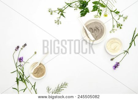 Natural Cosmetics Concept With Various Kinds Of Cosmetic Clays Ready For Spa Treatment Decorated Wit
