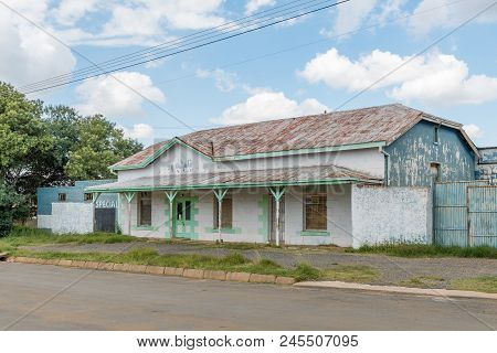 Zastron, South Africa - April 1, 2018: A Street Scene, With An Old, Disused Building, In Zastron In