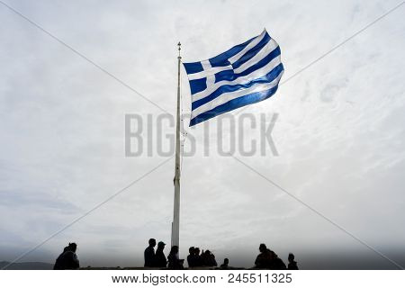 Athens, Greece - March 5, 2018 Blue White Greek Flag Summit Acropolis Athens Greece. Cross Symbolize