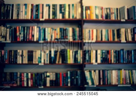 Shelves With Books In A Blurred Background. Abstract Colorful Blurred Background With Books. Learnin