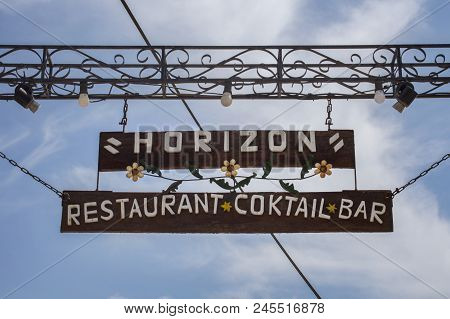 Paleokastritsa, Cofru, Greece- May 10, 2018 Hanging Welcome Signage Horizon Restaurant Cocktail Bar