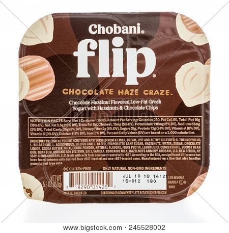 Winneconne, Wi -  13 June 2018: A Package Of Chobani Flip Chocolate Haze Craze Yogurt On An Isolated