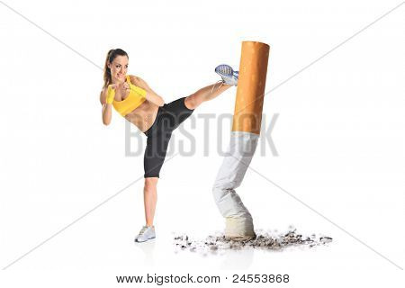 Girl kicking a cigarette butt isolated against white background