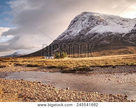 White Cottage At Snowy Glencoe In The Scottish Highlands, Cold Sunny Morning
