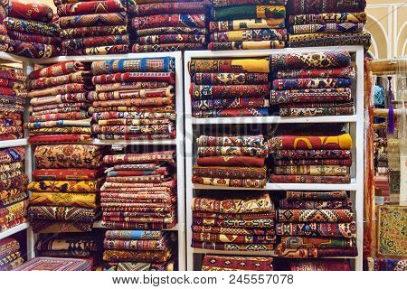 Heap Of Persian Carpets And Rugs On Shop In Yazd. Iran