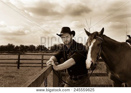 Good Looking, Hunky Cowboy Standing Next To His Stallion, Horse With Boots, Chequered Shirt And Hat