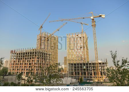 Hoisting Crane And New Multi-storey Building. Ndustrial Background. Construction Of High-rise Houses