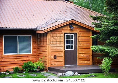 Front of rental cabin with cedar plank siding