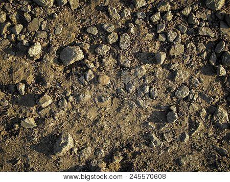 Stones On The Ground. Rock Background. Ground And Stones. Crushed Stones As Background Or Texture. S