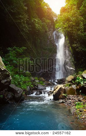 Waterfall and river in deep tropical forest