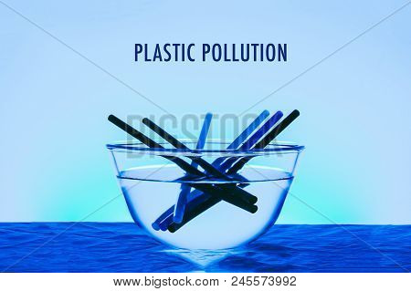 Plastic Pollution Title In The Ocean Concept Photo With Glass Of Bowl And Plastic Straw Blue Color E